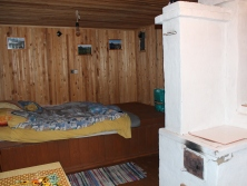 Dacha inside - wood-burn stove, bedding area